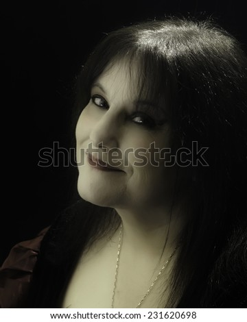 Dark Stylized Portrait of a woman in Theatrical Horror / Halloween / Gothic / Witch / Vampire make-up  - stock photo