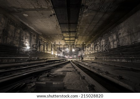 dark subway tunnel - stock photo