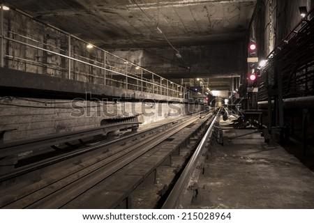 dark subway tunnel - stock photo