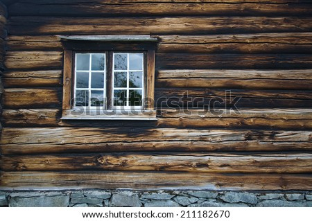 Dark timbered wooden wall with window - stock photo