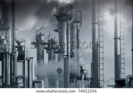 dark toxic clouds and smog over petrochemical oil and gas installation, blue toning concept - stock photo