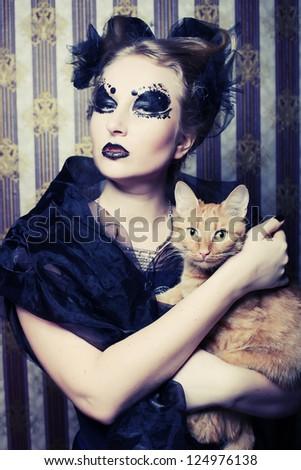 Dark vampire woman with cat - stock photo