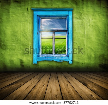 dark vintage green room with wooden floor and window with field and sky above it - stock photo