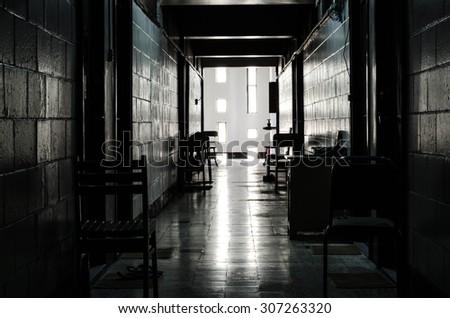 Dark walkways in the building - stock photo