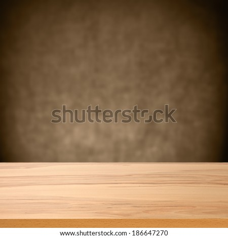 dark wall and empty desk  - stock photo