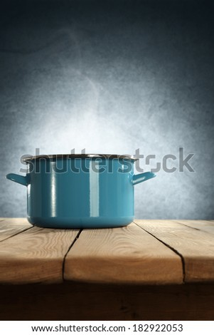 dark wall of blue and metal pot of blue