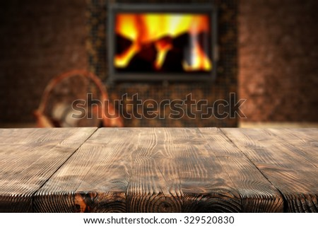dark wall with black fireplace with desk board and space for your decoration  - stock photo