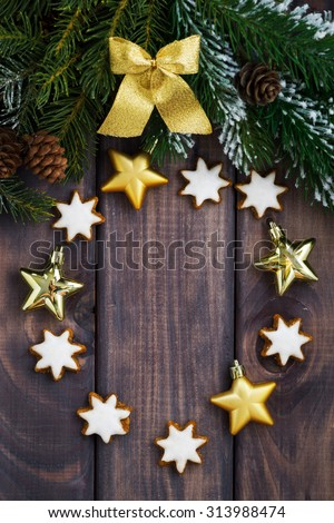 dark wood background with fir branches and decorations, vertical, top view, closeup - stock photo
