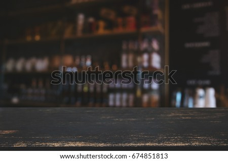 dark wood table with blur cafe interior decoration background
