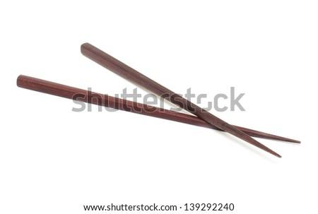 Dark wooden chopsticks on white background - stock photo