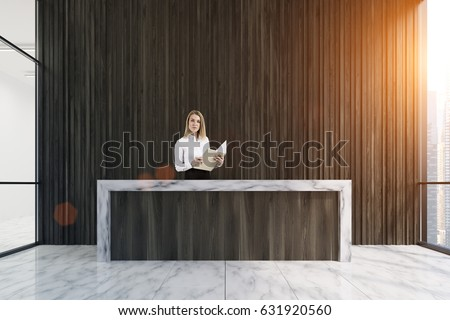 Dark wooden reception counter standing in an office lobby with large panoramic windows and blond businesswoman standing behind it. 3d rendering, toned image.