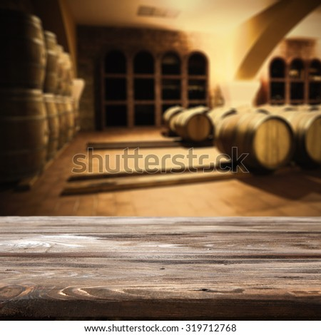 dark wooden table and barrels  - stock photo