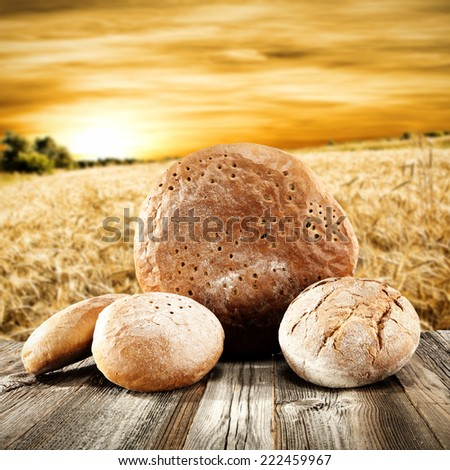 dark wooden table and few breads with sky