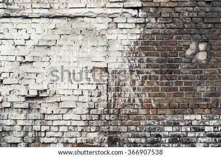 Dark worn brick wall. Big white paint splash. Industrial background.  - stock photo