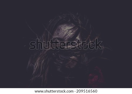 Dark, Young girl with hair flying, concept nightmares - stock photo