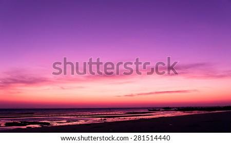 Darkening Heavens Fiery Backdrop  - stock photo