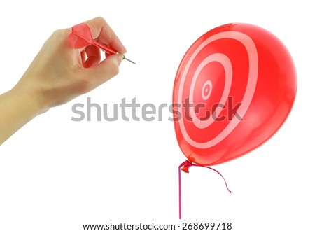 Dart about to pop a balloon isolated on white - stock photo