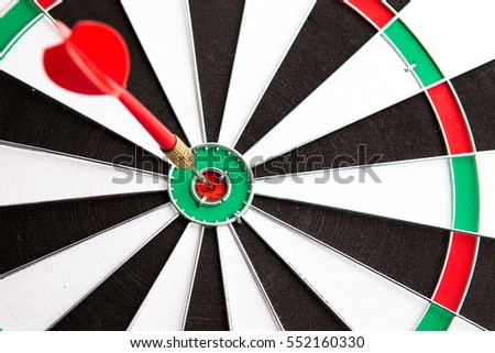 Dart arrow hitting in the target center,Concept of personal coaching success