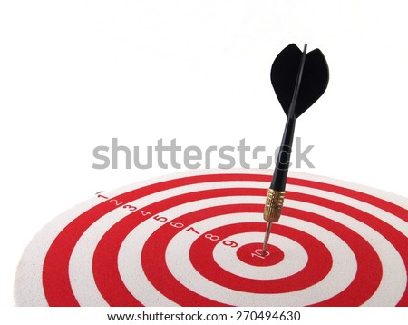 dart arrow hitting in the target center of dartboard on white background - stock photo