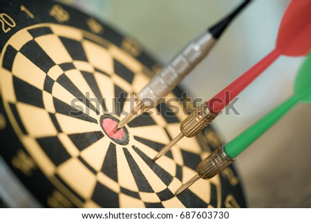 Dart arrow hitting in the target center of dartboard using as background Target business, achieve and victory,success concept.
