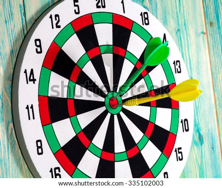 dart board with darts on background
