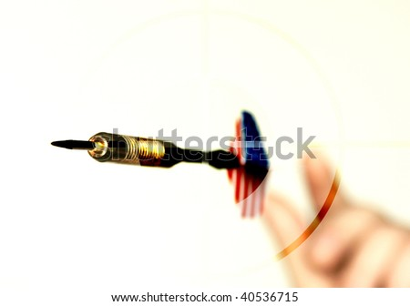 dart flying in target from hand - stock photo