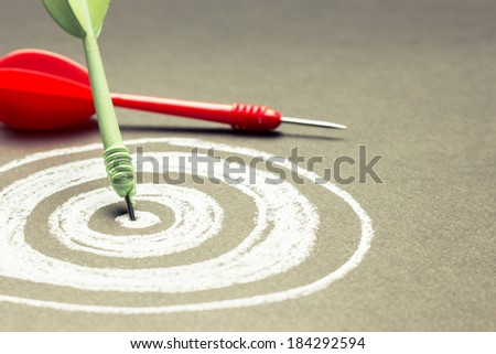 Dart hit on the center of sketching dartboard with copy space - stock photo