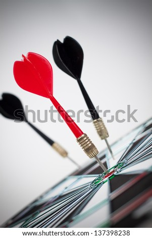 dart hit the dead centre of the target - stock photo