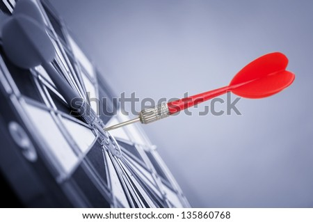 dart in center of target - stock photo
