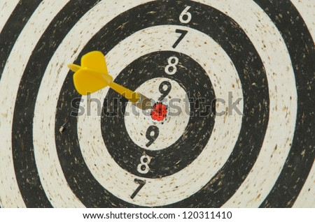 Dart in dartboard - stock photo