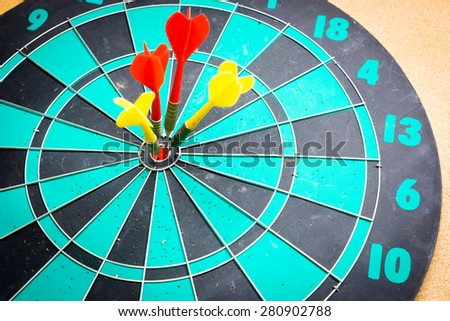 Dart is an opportunity and Dartboard is the target and goal. So both of that represent a challenge. Bullseye and Dart. - stock photo