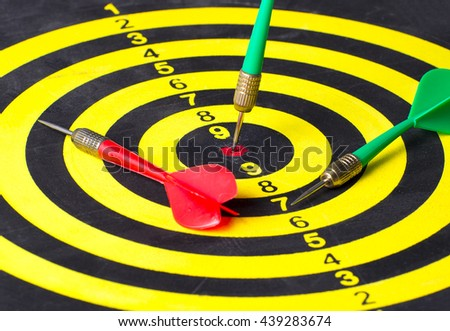 Dart target with arrow on bullseye in dartboard, Goal target success business investment financial strategy concept, abstract background - stock photo
