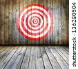 Dartboard on wooden wall - stock photo