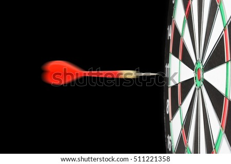 Dartboard, red arrow motion blur to target, isolated on black background