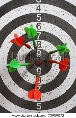 Dartboard with darts - stock photo