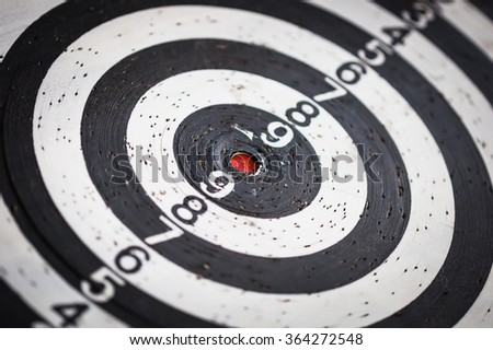 dartboard with red dot on target center