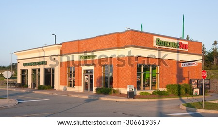 DARTMOUTH, CANADA -AUGUST 16, 2015: Quiznos is a fast-food restaurant brand specializing in toasted submarine sandwiches. Starbucks is the largest coffeehouse company in the world.