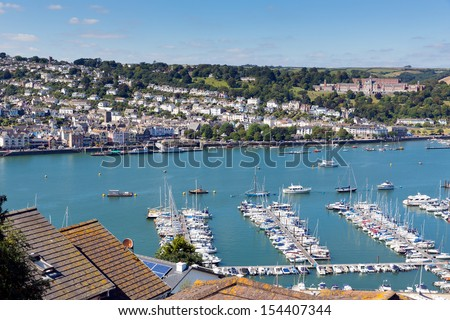 Dartmouth Devon viewed from Kingswear, with boats on Dart river and blue sky on summer day - stock photo