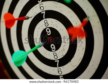 Dartrs target with arrows - stock photo