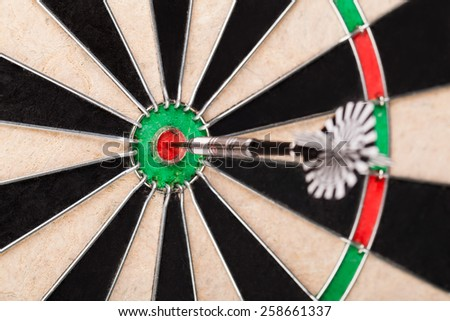 darts arrows in the target
