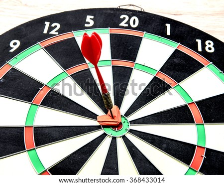 darts arrows in the target center with heart