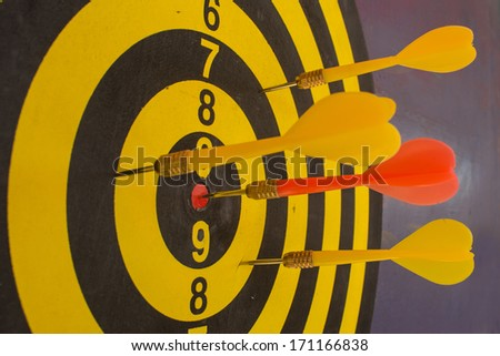 Darts hit the target - stock photo