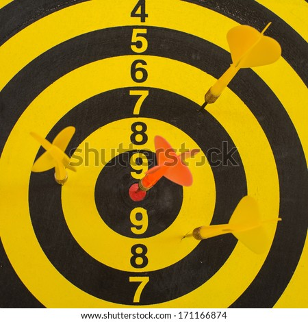 Darts hit the target, preferably - stock photo
