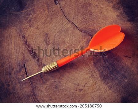darts on wood background old retro vintage style - stock photo