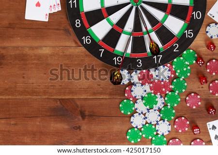 darts on wooden background. Business concept. Success hitting target aim goal achievement concept background. background for gambling - stock photo
