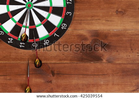 darts on wooden background. Business concept. Success hitting target aim goal achievement concept background.