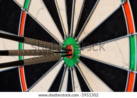 Darts With Three Arrows Into Center