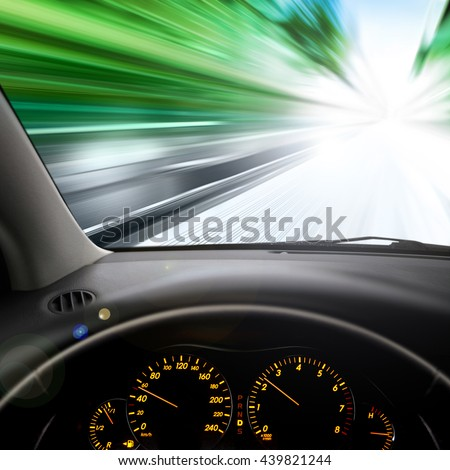 dashboard and view on car windshield - stock photo