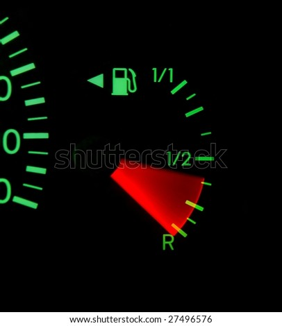 Dashboard indicator showing fuel running out, mileage - stock photo