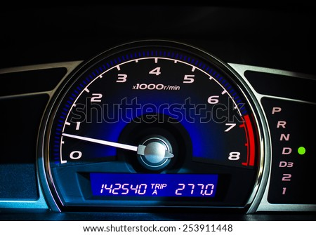Dashboard of a car with a high mileage.